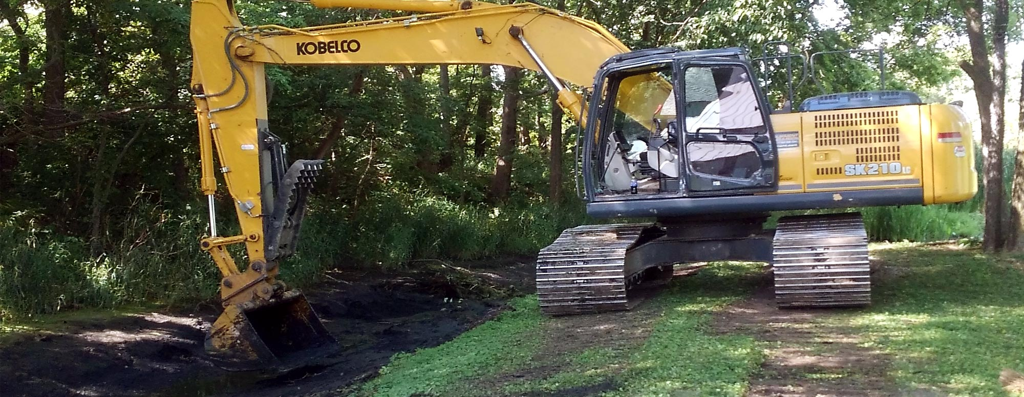 Large excavator digging for a septic system