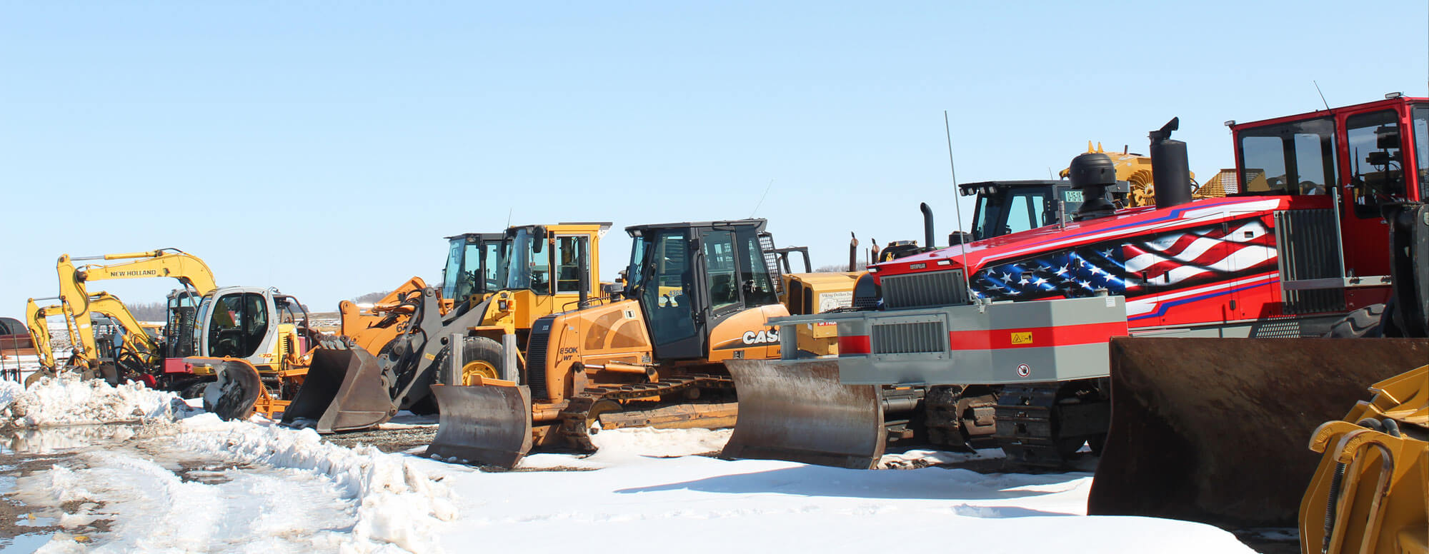 Row of Dahle Enterprises' excavating equipment in winter