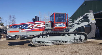 Dahle Enterprises' American-Flag themed field tiling machine | Field Drainage