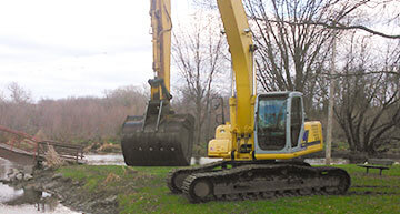 Large Excavator lifing its bucket | Excavating Services